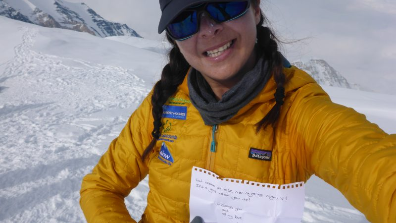 Alex reading a friend's letter on the summit of Denali, N. America