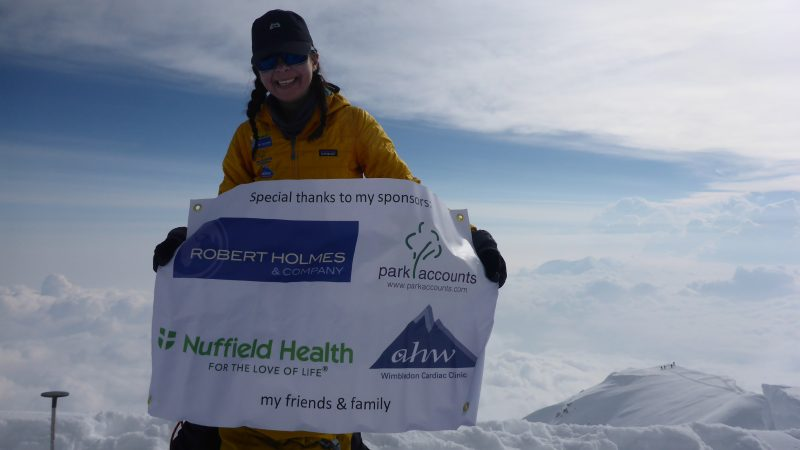 Denali summit with sponsors banner